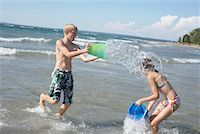 Kids Playing on the Beach, Elmvale, Ontario, Canada    Stock Photo - Premium Royalty-Freenull, Code: 600-02265291