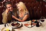 Couple Dining in Restaurant    Stock Photo - Premium Rights-Managed, Artist: Marc Vaughn, Code: 700-02265243