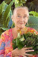 Portrait of Mature Woman Holding Plant    Stock Photo - Premium Royalty-Freenull, Code: 600-02265498