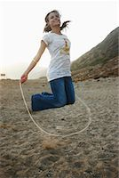 Woman Skipping on Beach    Stock Photo - Premium Rights-Managednull, Code: 700-02265421