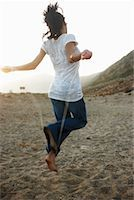 Woman Skipping on Beach    Stock Photo - Premium Rights-Managednull, Code: 700-02265422