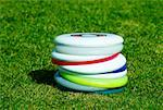 Close-up of a stack of plastic discs Stock Photo - Premium Royalty-Freenull, Code: 625-02266311