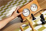 Close-up of a human hand pushing button of a chess clock Stock Photo - Premium Royalty-Freenull, Code: 625-02266371