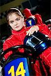Female go-cart racer sitting in a sports car and thinking Stock Photo - Premium Royalty-Free, Artist: Zoomstock, Code: 625-02266406