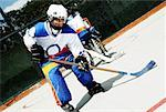 Boy playing ice hockey Stock Photo - Premium Royalty-Free, Artist: George Simhoni, Code: 625-02266421
