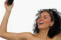 Close-up of a young woman listening to an MP3 player Stock Photo - Premium Royalty-Freenull, Code: 625-02266721