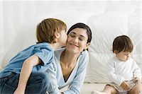 people kissing little boys - Little boy kissing mother's cheek, toddler girl sitting nearby Stock Photo - Premium Royalty-Freenull, Code: 632-02282890