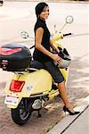Woman Sitting on Motor Scooter    Stock Photo - Premium Royalty-Free, Artist: George Remington, Code: 600-02288382