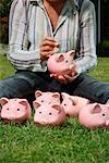 Woman on Grass with Piggy Banks    Stock Photo - Premium Rights-Managed, Artist: Leonardo, Code: 700-02289311
