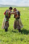 Men in Traditional Costumes Wrestling, Inner Mongolia, China    Stock Photo - Premium Rights-Managed, Artist: dk & dennie cody, Code: 700-02289813