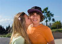 Teen girl kissing teen boy Stock Photo - Premium Royalty-Freenull, Code: 649-02290305
