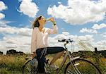 Female cyclist drinking water Stock Photo - Premium Royalty-Free, Artist: Cultura RM, Code: 649-02290741