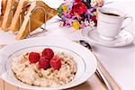 Plain porridge served with raspberries, on the breakfast table.    Stock Photo - Premium Rights-Managed, Artist: foodanddrinkphotos, Code: 824-02291316