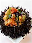 Urchin stuffed with salmon and seaweed tartare    Stock Photo - Premium Rights-Managed, Artist: Photocuisine, Code: 825-02306648