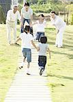 Running children and family Stock Photo - Premium Royalty-Free, Artist: Boden/Ledingham, Code: 670-02309616