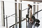 Businesspeople pulling suitcases in lobby Stock Photo - Premium Royalty-Freenull, Code: 635-02312674