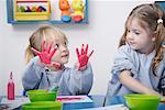 Girls finger-painting in classroom Stock Photo - Premium Royalty-Free, Artist: Mark Tomalty, Code: 635-02312863
