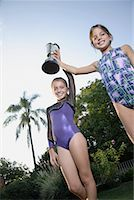 preteen girls gymnastics - Young gymnasts holding trophy Stock Photo - Premium Royalty-Freenull, Code: 635-02312889