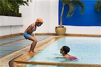 Girls Playing in Pool    Stock Photo - Premium Rights-Managednull, Code: 700-02314925