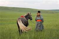 Horseman Walking with Horse, Inner Mongolia, China    Stock Photo - Premium Rights-Managednull, Code: 700-02314933