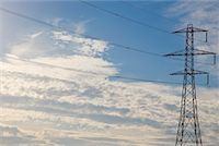 Electricity pylon with blue sky    Stock Photo - Premium Rights-Managednull, Code: 822-02315422