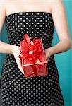 Woman Holding Present Behind Back    Stock Photo - Premium Rights-Managed, Artist: SEED9, Code: 700-02332667