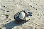 Stones stacked on top of driftwood on raked sand Stock Photo - Premium Royalty-Free, Artist: Oriental Touch, Code: 633-02345740