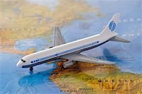 Toy Airplane on Map    Stock Photo - Premium Royalty-Freenull, Code: 600-02346186