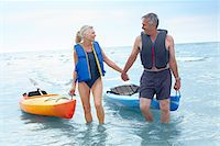 seniors woman in swimsuit - Man and Woman Bringing Kayaks out of the Water Stock Photo - Premium Royalty-Free, Artist: Jerzyworks, Code: 600-02346296