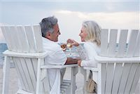 Couple Toasting with Wine while Sitting on Chairs on Beach    Stock Photo - Premium Royalty-Freenull, Code: 600-02346334