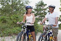 Couple Bike Riding, Elmvale, Ontario, Canada    Stock Photo - Premium Rights-Managednull, Code: 700-02346549