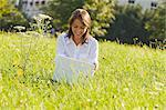 Woman in Meadow with Laptop Computer, Salzburg, Salzburger Land, Austria    Stock Photo - Premium Rights-Managed, Artist: Bryan Reinhart, Code: 700-02347526