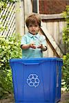 Boy Recycling Plastic Bottle    Stock Photo - Premium Rights-Managed, Artist: Peter Reali, Code: 700-02347721