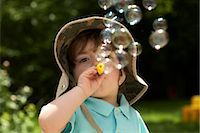 Boy Blowing Bubbles    Stock Photo - Premium Rights-Managednull, Code: 700-02347734