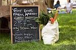 Chalkboard Sign and Grocery Bag at Farmer's Market    Stock Photo - Premium Rights-Managed, Artist: Peter Reali, Code: 700-02347756