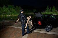 Man Disposing of Woman's Body    Stock Photo - Premium Royalty-Freenull, Code: 600-02348074