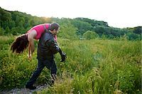 Man Carrying Woman's Body into Field, Toronto, Ontario, Canada    Stock Photo - Premium Rights-Managednull, Code: 700-02348157