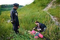 Coroner Examining Woman's Body in Field, Toronto, Ontario, Canada    Stock Photo - Premium Rights-Managednull, Code: 700-02348162