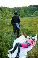 Police Officer with Woman's Body in Field, Toronto, Ontario, Canada    Stock Photo - Premium Rights-Managednull, Code: 700-02348163
