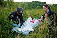 Police Officers with Woman's Body in Field, Toronto, Ontario, Canada    Stock Photo - Premium Rights-Managednull, Code: 700-02348164