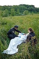 Police Officers with Woman's Body in Field, Toronto, Ontario, Canada    Stock Photo - Premium Rights-Managednull, Code: 700-02348167