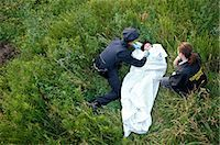 Police Officers with Woman's Body in Field, Toronto, Ontario, Canada    Stock Photo - Premium Rights-Managednull, Code: 700-02348168