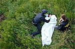 Police Officers with Woman's Body in Field, Toronto, Ontario, Canada    Stock Photo - Premium Rights-Managed, Artist: Blue Images Online, Code: 700-02348168