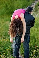 Man Carrying Woman over Shoulder, Toronto, Ontario, Canada    Stock Photo - Premium Rights-Managednull, Code: 700-02348198