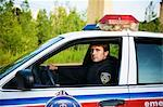 Police Officer in Cruiser, Toronto, Ontario, Canada    Stock Photo - Premium Rights-Managed, Artist: Blue Images Online, Code: 700-02348220