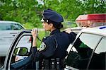Police Woman with Cruiser at Side of Road, Toronto, Ontario, Canada    Stock Photo - Premium Rights-Managed, Artist: Blue Images Online, Code: 700-02348229