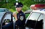 Police Woman with Cruiser at Side of Road, Toronto, Ontario, Canada    Stock Photo - Premium Rights-Managed, Artist: Blue Images Online, Code: 700-02348230
