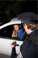 female police officer happy - Police Officer Pulling Woman Over, Toronto, Ontario, Canada    Stock Photo - Premium Rights-Managednull, Code: 700-02348234