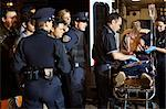 Police and Paramedics with Injured man by Ambulance and Crowd, Toronto, Ontario, Canada    Stock Photo - Premium Rights-Managed, Artist: Blue Images Online, Code: 700-02348238