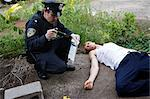 Police Officer with Evidence and Corpse on Crime Scene, Toronto, Ontario, Canada    Stock Photo - Premium Rights-Managed, Artist: Blue Images Online, Code: 700-02348262